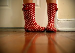 Girl wears polka-dotted rainboots